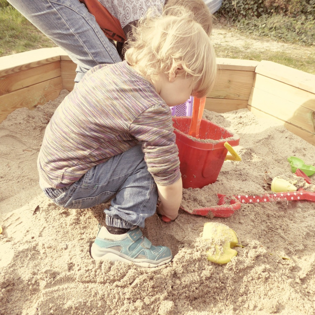 Playing in the sand teaches many pre-math and pre-science concepts.