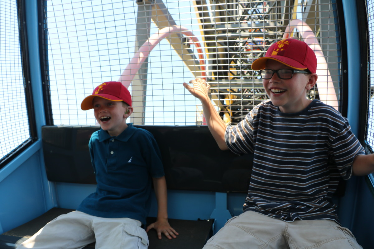 Riding on one of the sliding cars on the Fun Wheel is thrilling for older children, but smaller kids may prefer the stationary cars.