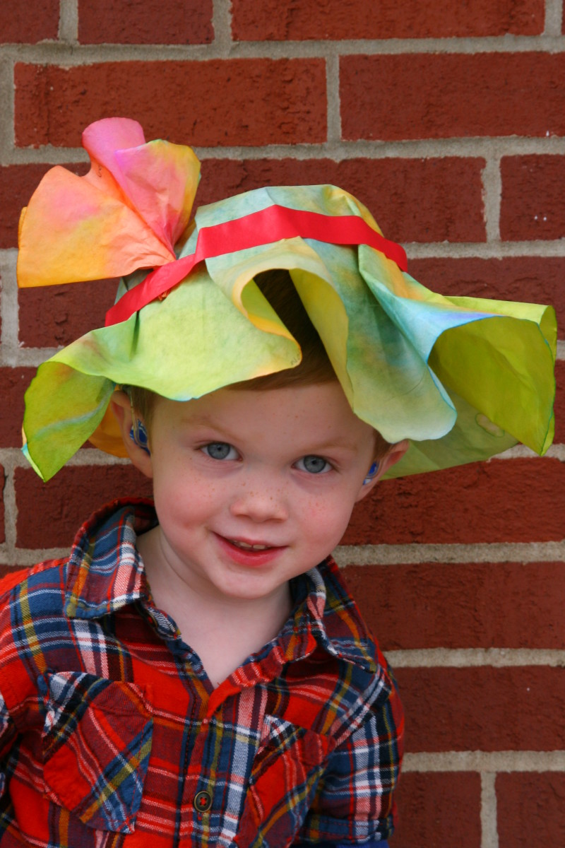 A preschool aged boy in an Easter Bonnet at a community run preschool. It is important to ask about preschool educational philosophies. Ask about how diversity, religious festivals, cultural rites, and other matters are handled in the school.