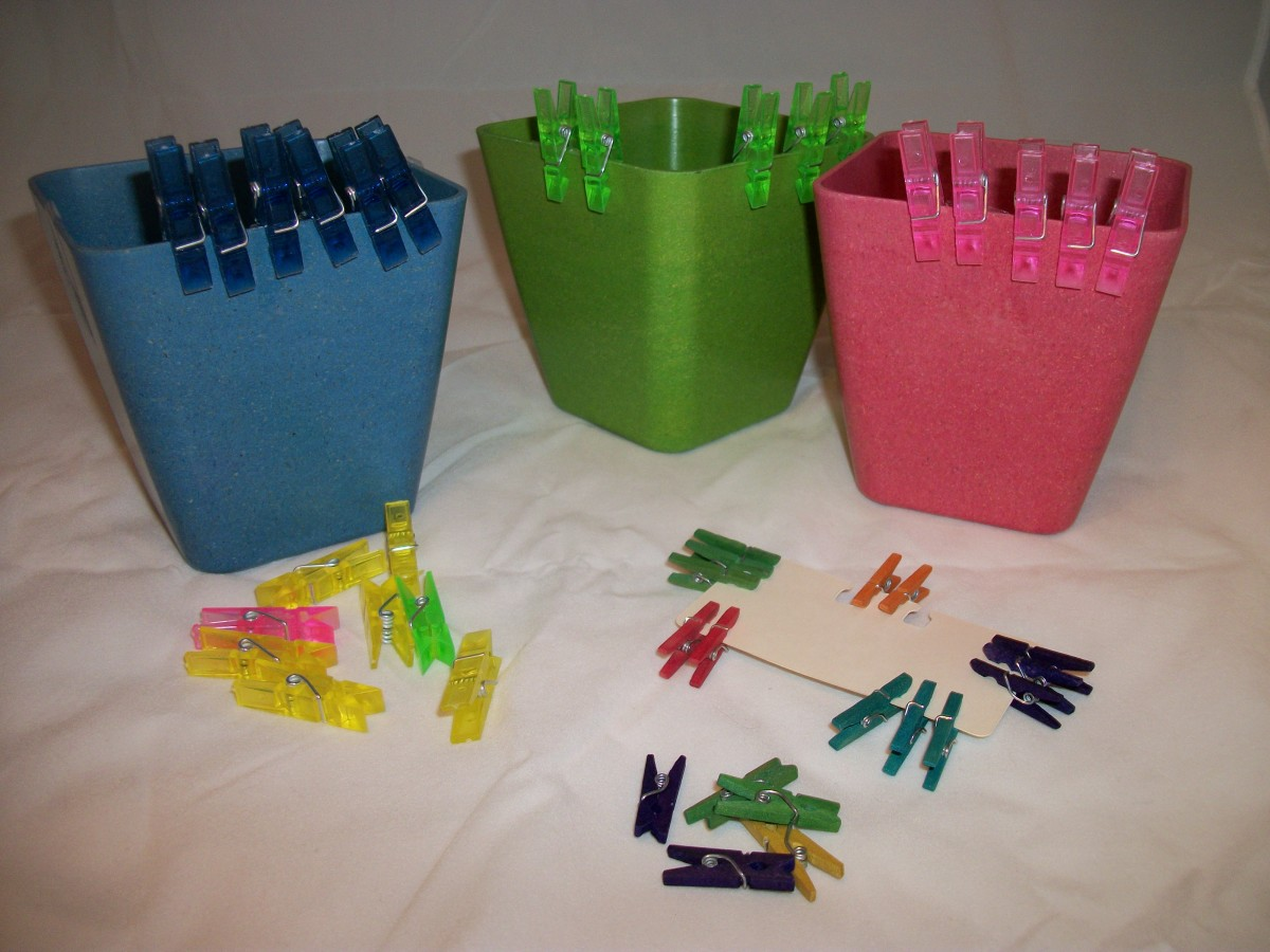 Large and small clothespins sorted by color