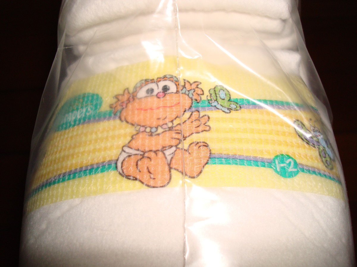 A close-up of the (slightly creepy?) baby Sesame Street characters on Pampers.
