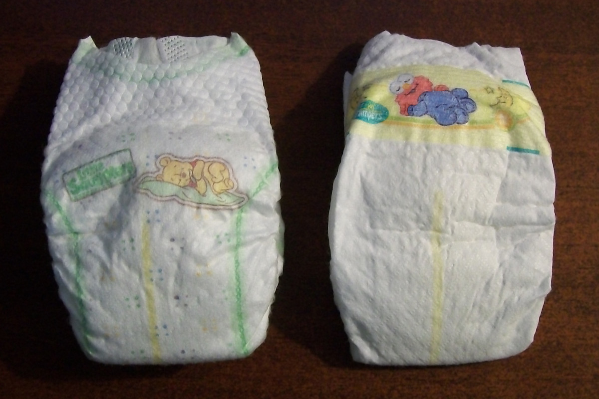 The baby Winnie-the-Pooh characters on the Huggies diapers can be seen on the left, while the Pampers feature baby Sesame Street characters on the right.
