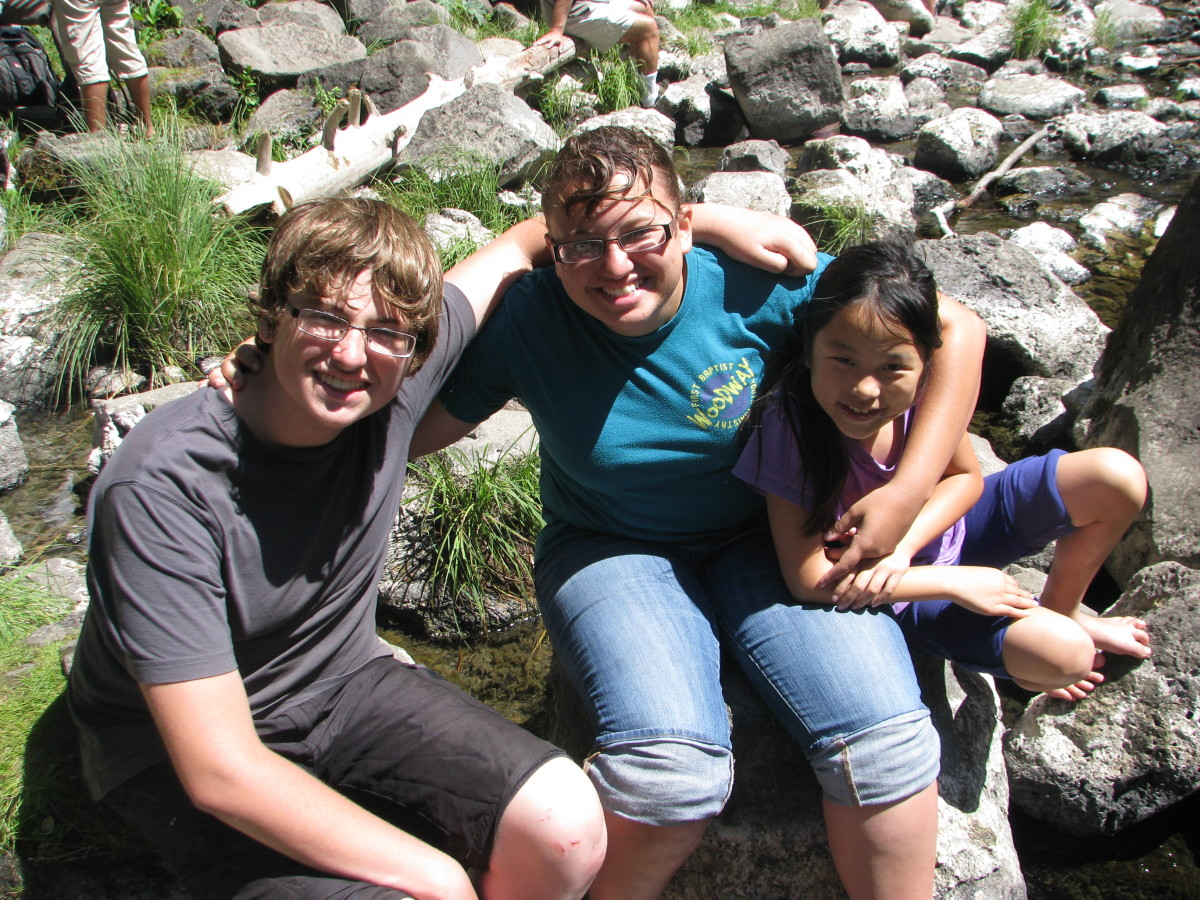 Our adopted daughter,Mollie, nine years later with her two older siblings.