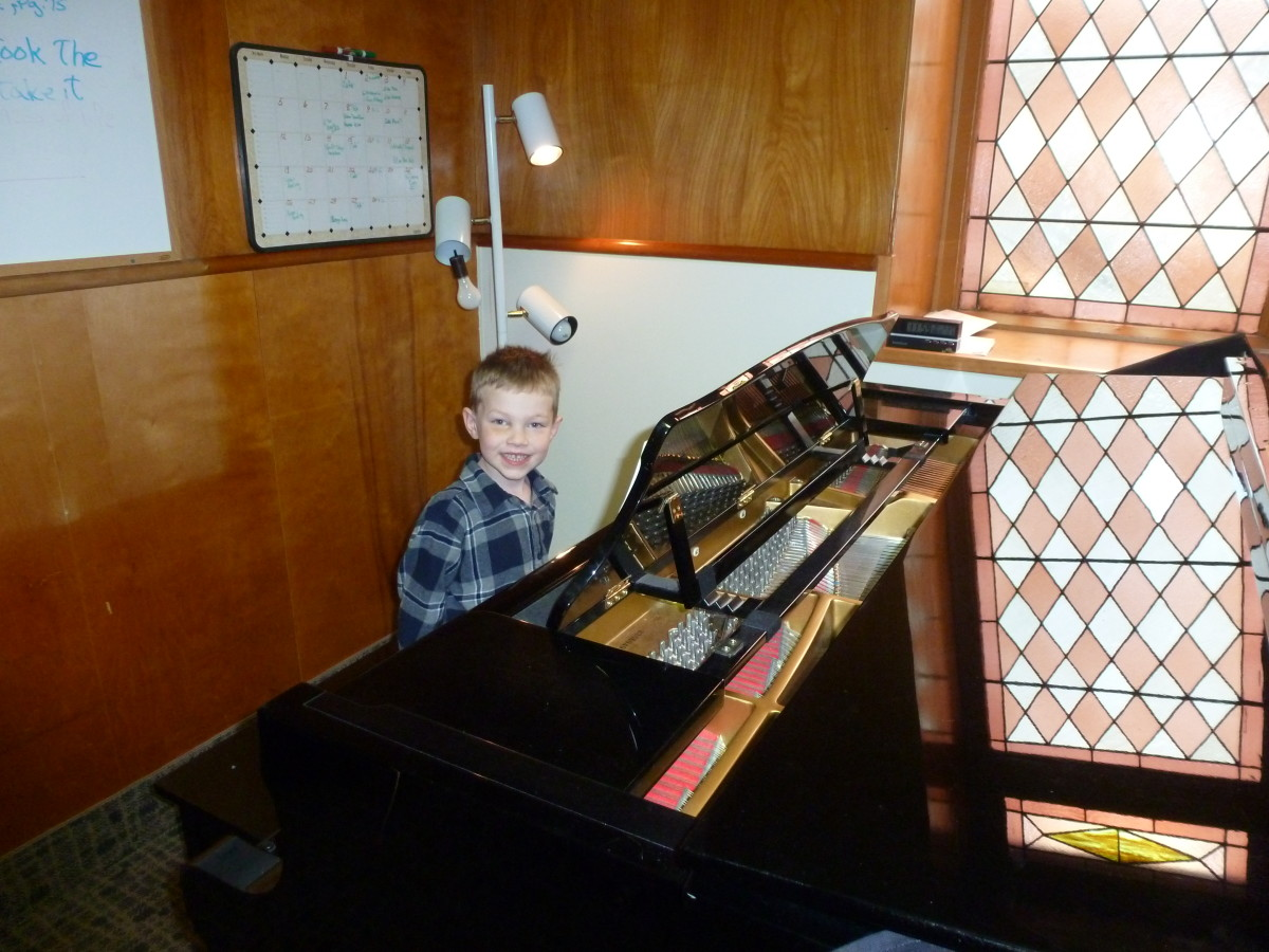 "My Kindergarten-aged son during a piano lesson - we booked a ""test"" session to see if he was old enough to learn music sight-reading."