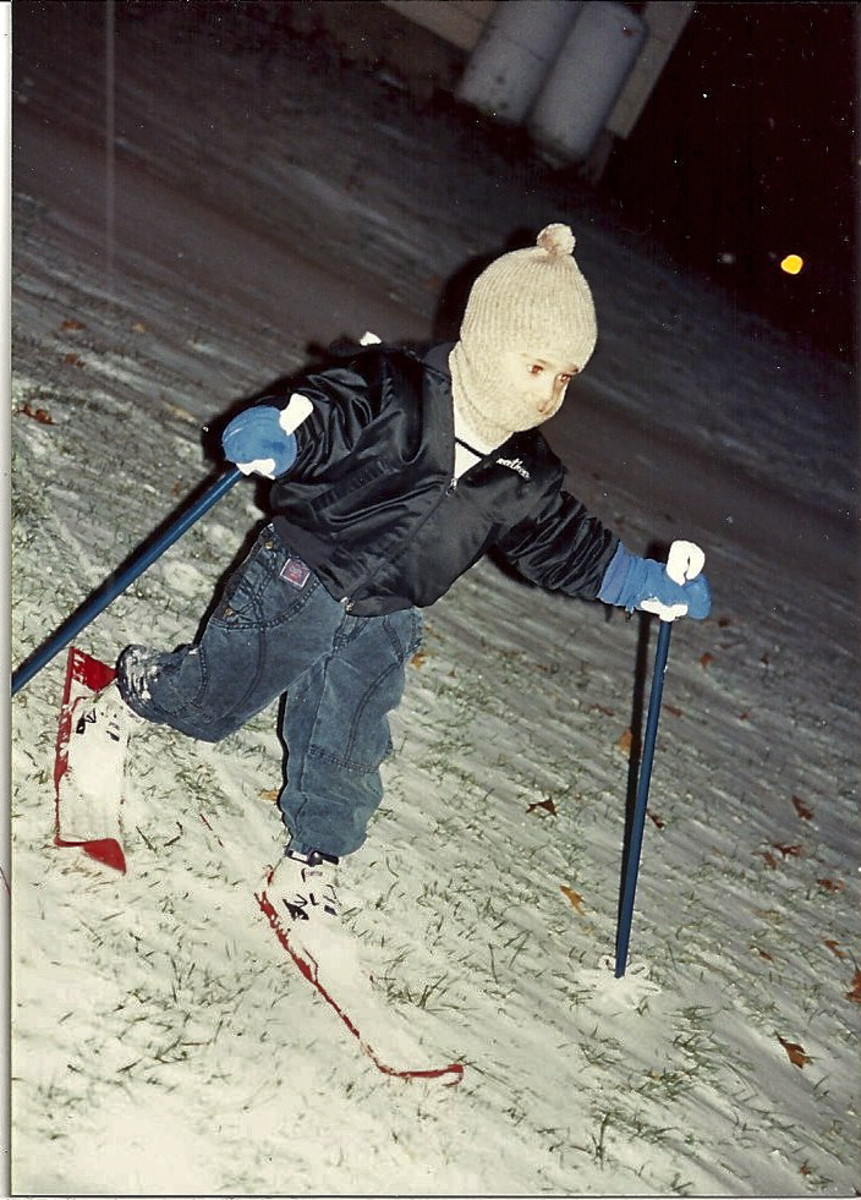Our grandson on his first pair of skiis as he slid down a small hill behind our house.
