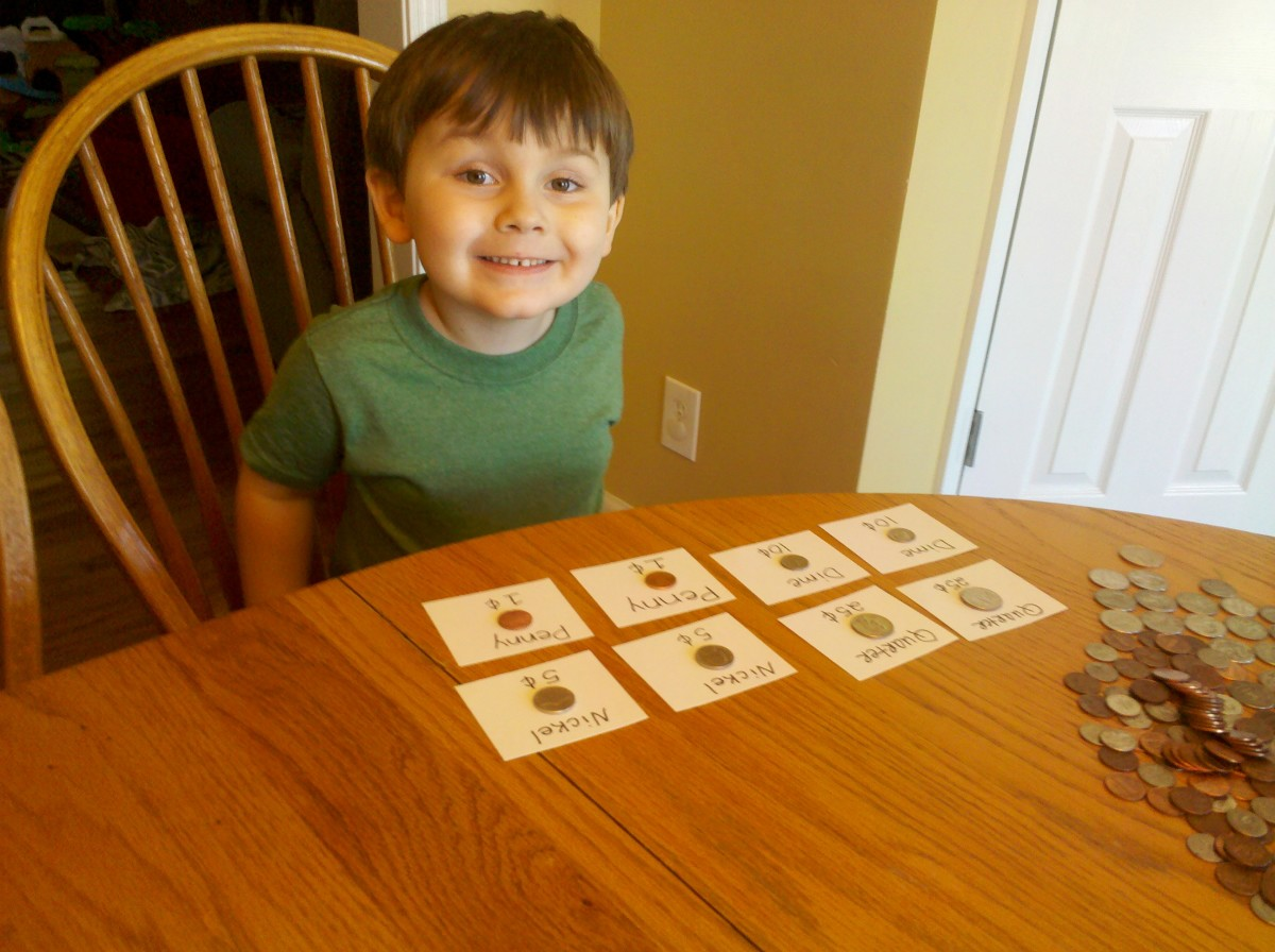My son matching all the coin flashcards!