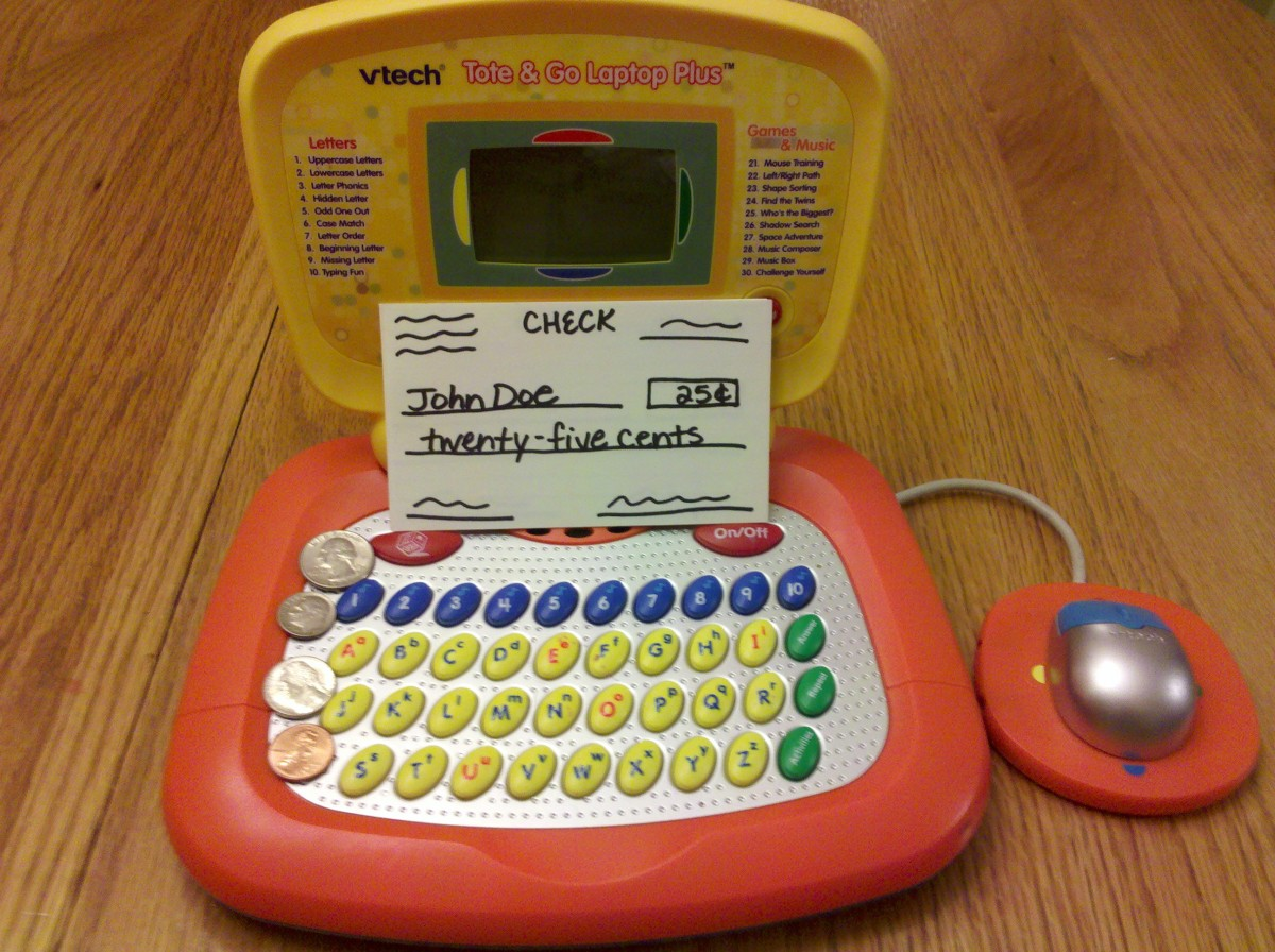 Set up a pretend bank with a toy laptop and pretend checks!