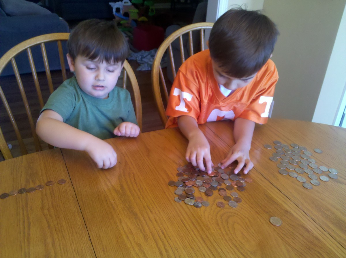 My boys sorting and stacking their coins.