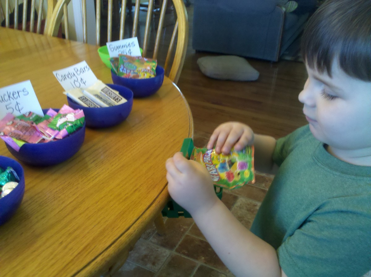 My son deciding on a pack of gummies for a quarter at the candy store.