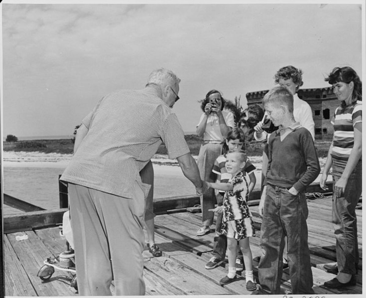 President Truman shaking hands with a child upon his arrival at the Fort Jefferson National Monument.