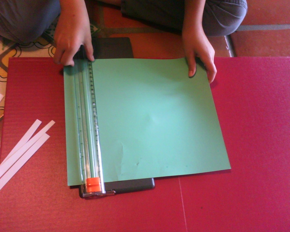 Step Four: Cut some colored paper for matting the parts of your project (we like colored scrapbook paper)