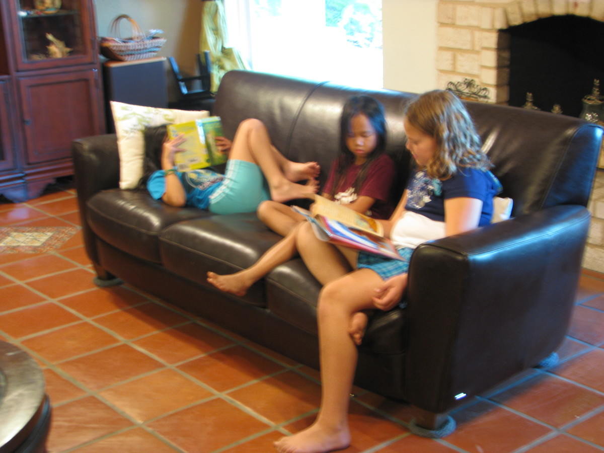 Sisters Reading.  Doing things together with siblings creates memories and wonderful sibling bonds.