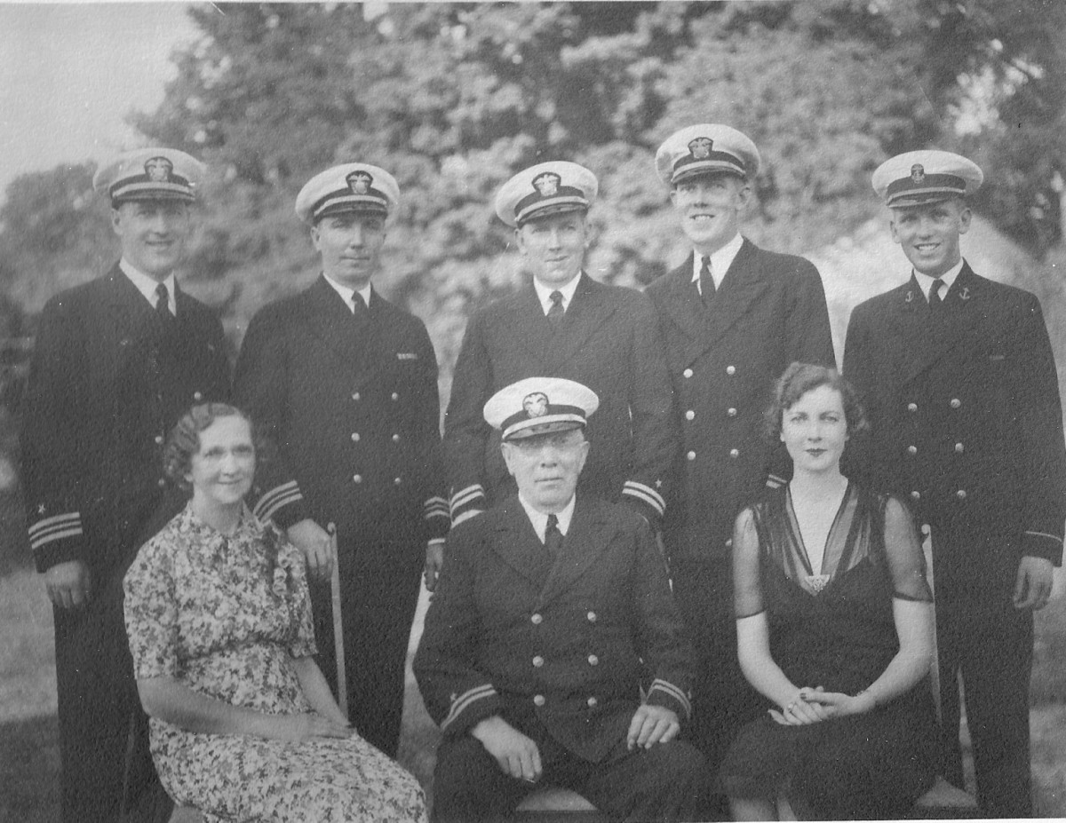 The five Olsen brothers in 1938 ( standing) with their parents and sister( seated)