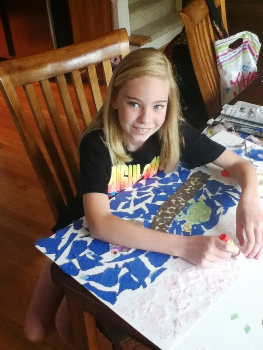 My daughter working on her paper mosaic