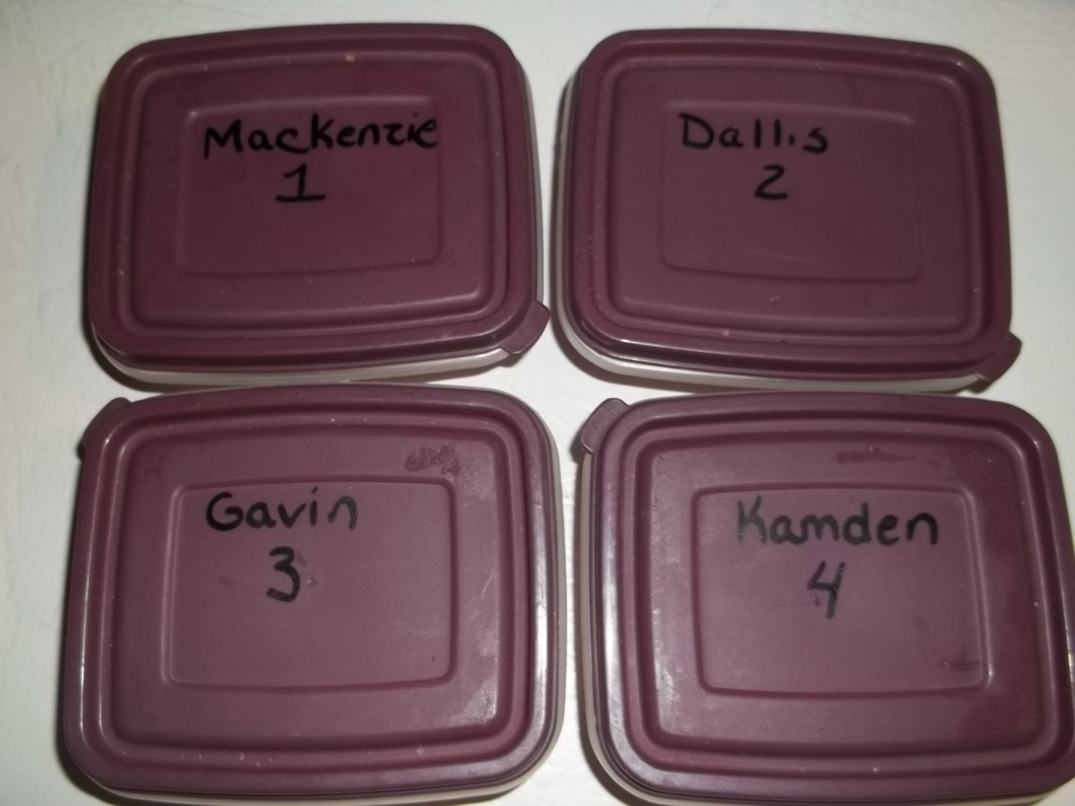 Containers designated to each child to hold their tokens for the month.