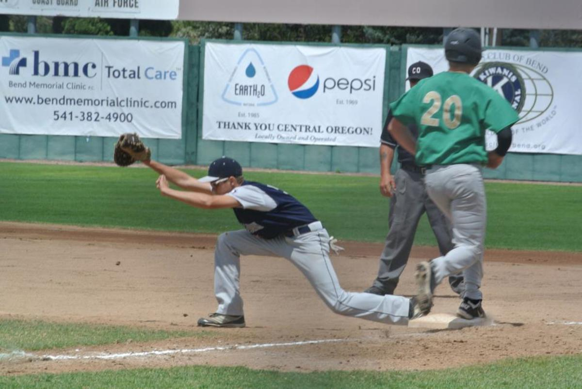 First baseman makes the stretch for the out