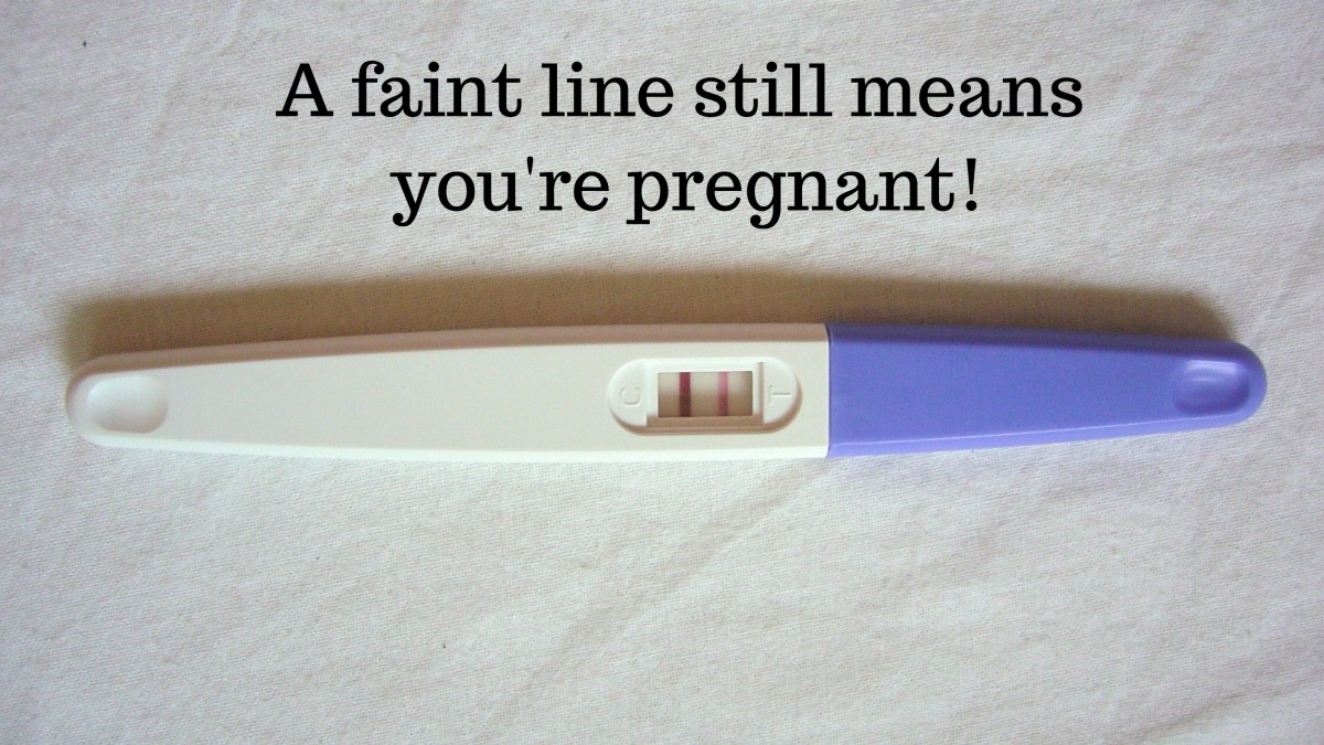 In this home pregnancy test, the test line is darker than the positive line, but it still means there's a pregnancy.