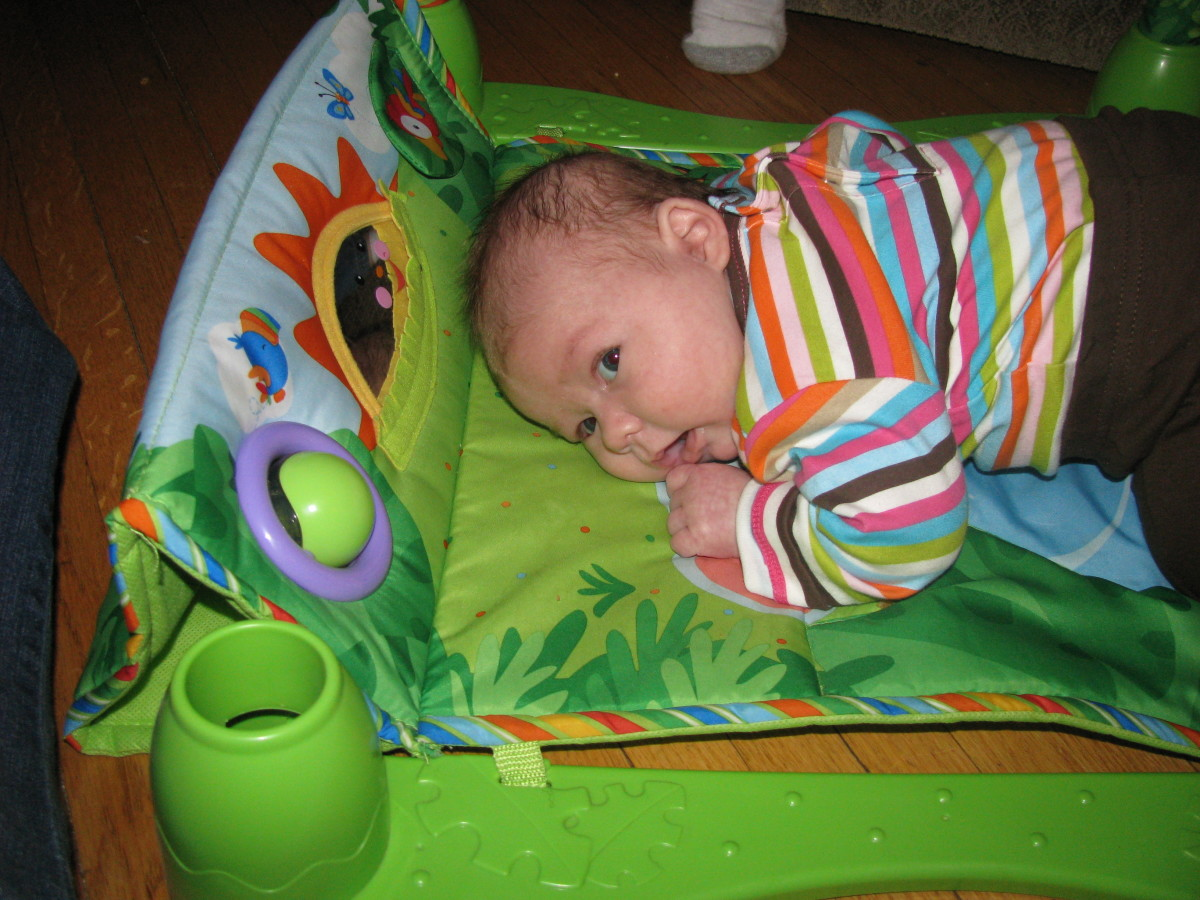A tummy time mat gives a newborn a comfy and fun area to exercise the neck muscles.