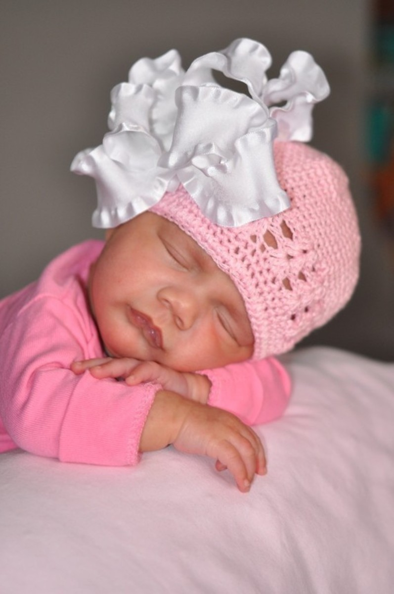 #1 Sleeping Infant with Pink Cap and White Bow