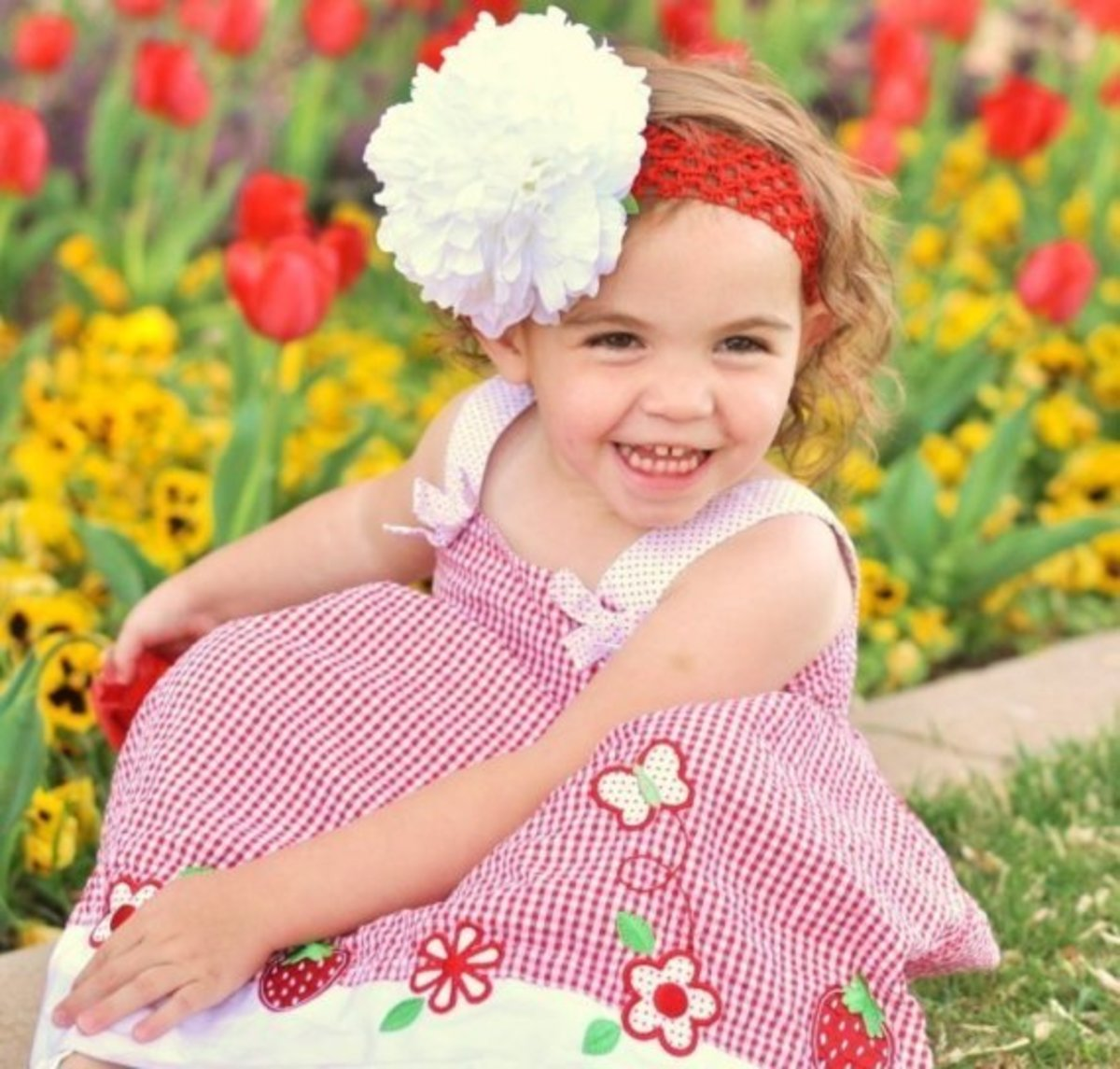 #3 Girl in Red Checked Dress Sitting Among Flowers