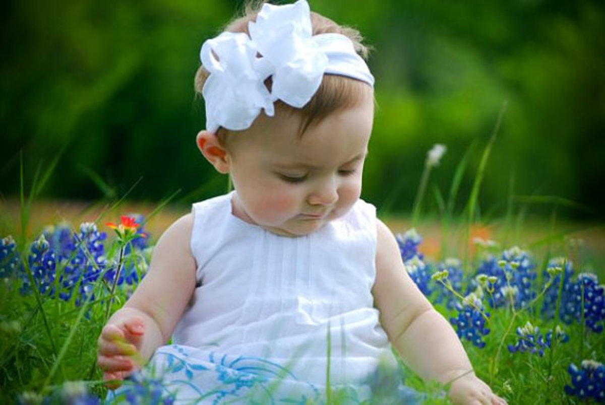 #2 Baby Girl in White Dress, White Bow and Blue Flowers