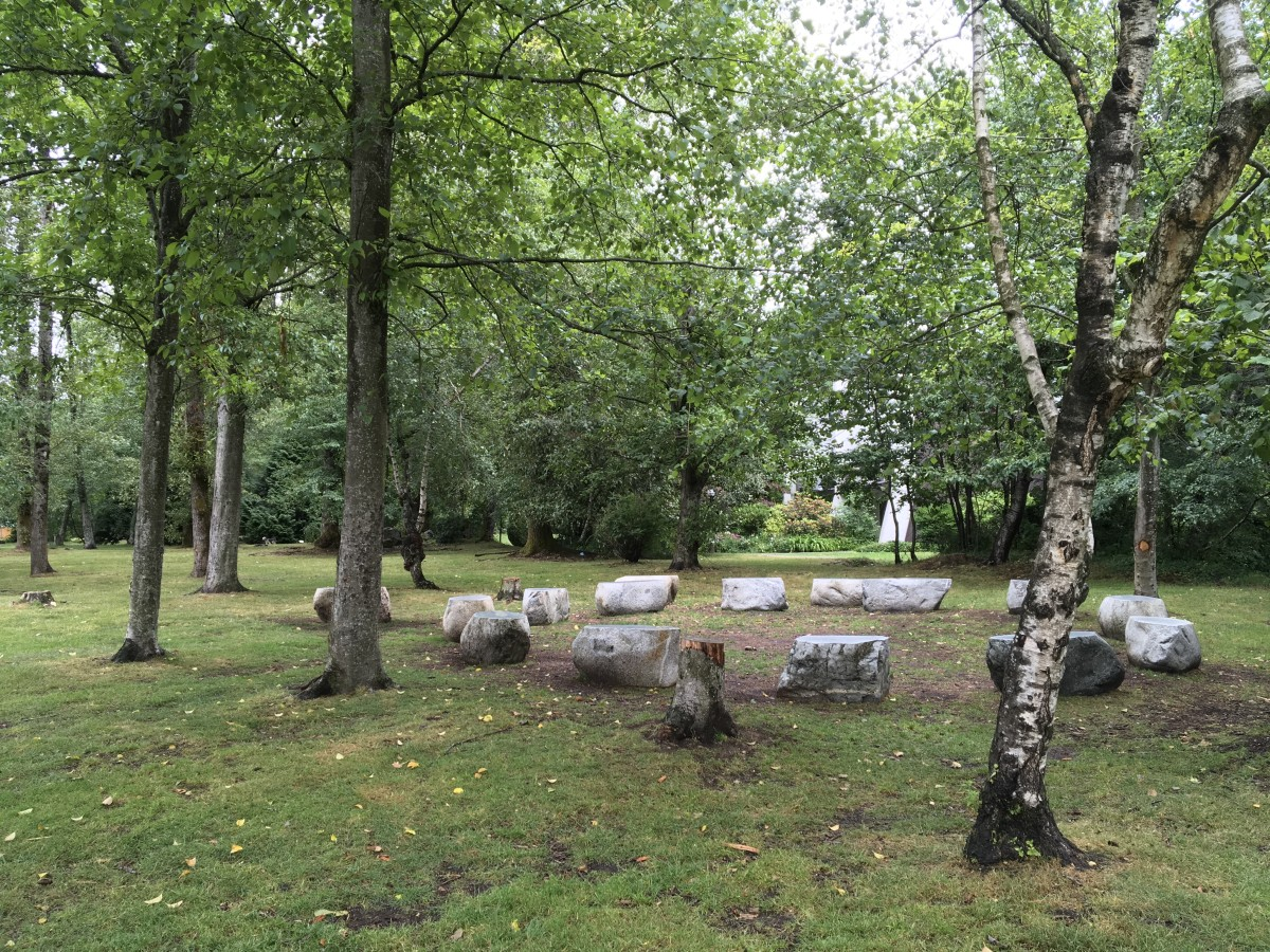 The seats in the outdoor classroom are rocks with flat and polished tops.