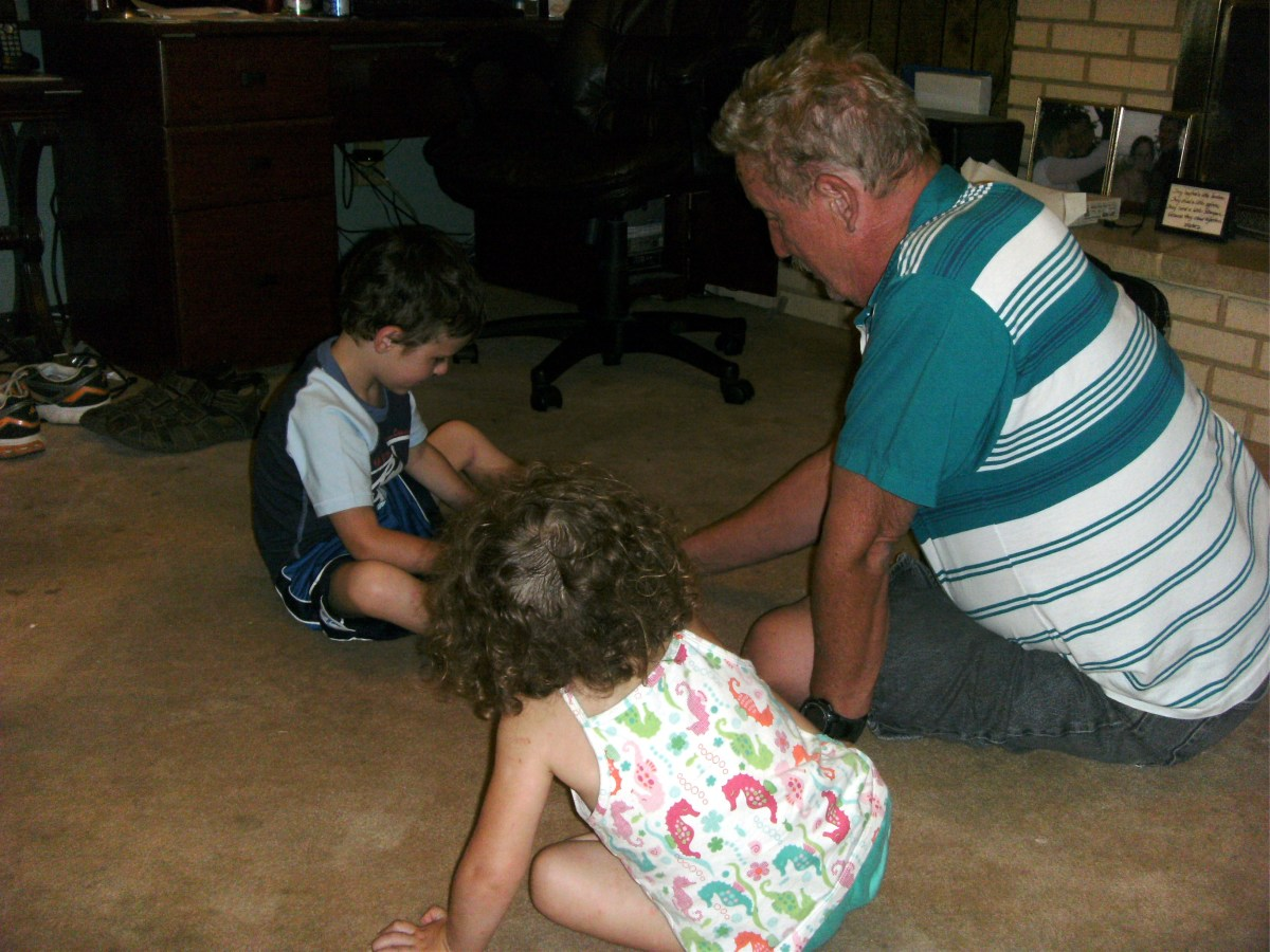 Although little sister is still rather young, Grandpa playing with cars means that she can do the same and have fun, too.