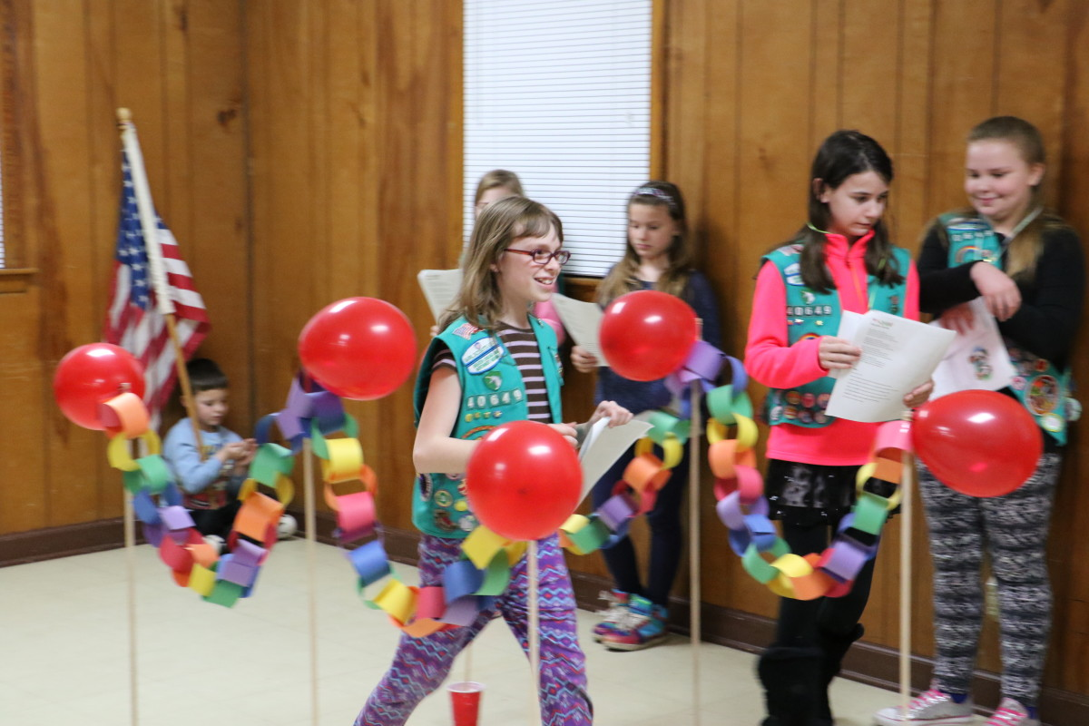 Some awards carry over when girls bridge to the next age level. Here, a troop participates in a bridging ceremony.
