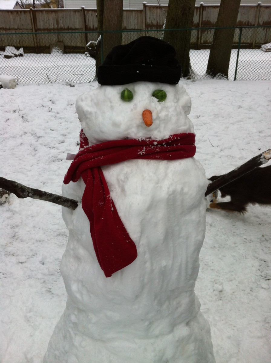 Building a snowman is fun for kids of all ages.