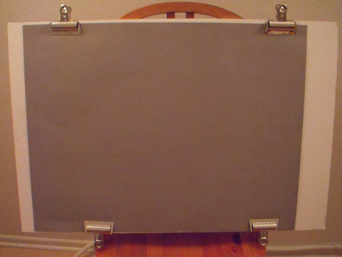 Make your own drawing board with foam core board and Bulldog clips. Lightweight and economical.