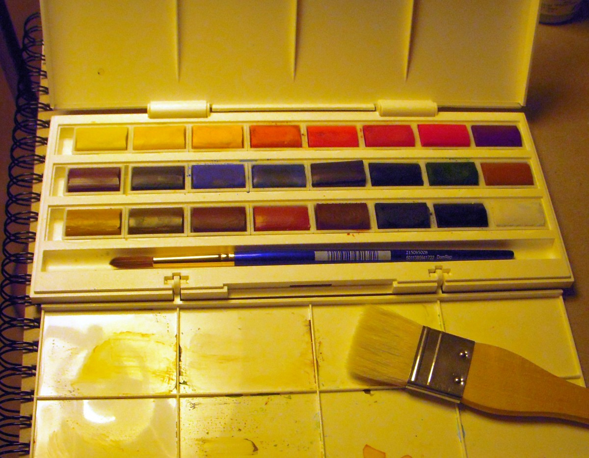 Even young children find watercolor pan sets easy to use.