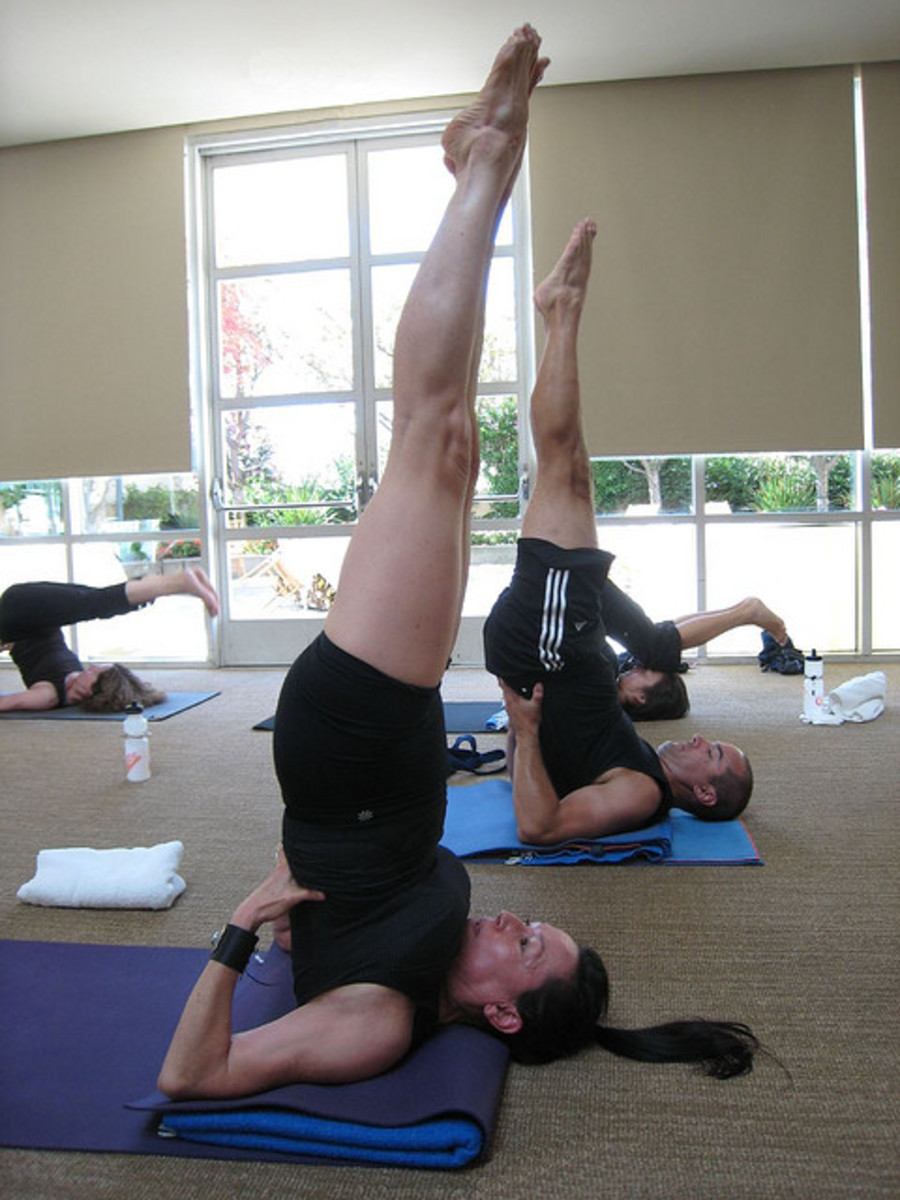 Be careful not to move your head or neck during a shoulder stand. Use your hands on your back to push yourself further upright.