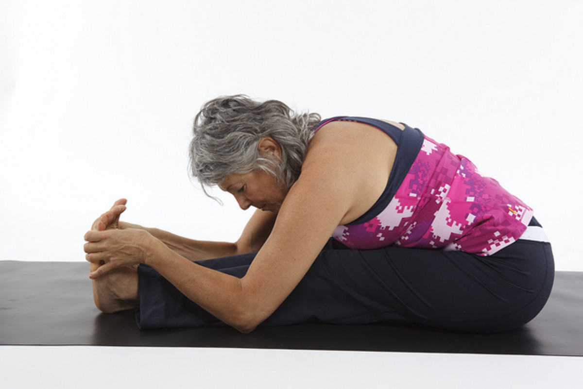 Only stretch as far forward as is comfortable for you. Everyone's flexibility is different.