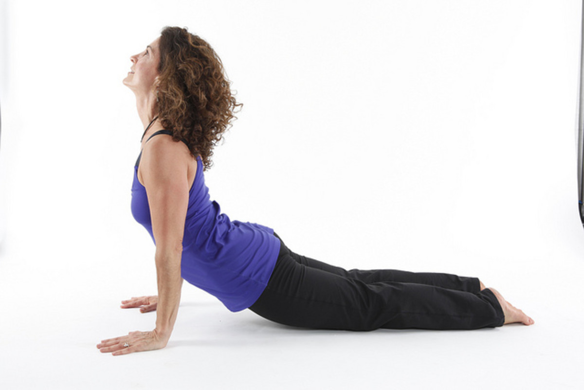 If you are not that flexible in your back, don't lift yourself as far as this; rest on your lower arms instead.