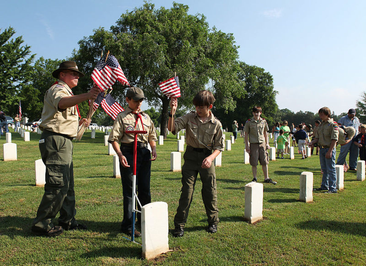 It is common practice for Boy Scout troops nationwide to place flags on military graves on Memorial Day.