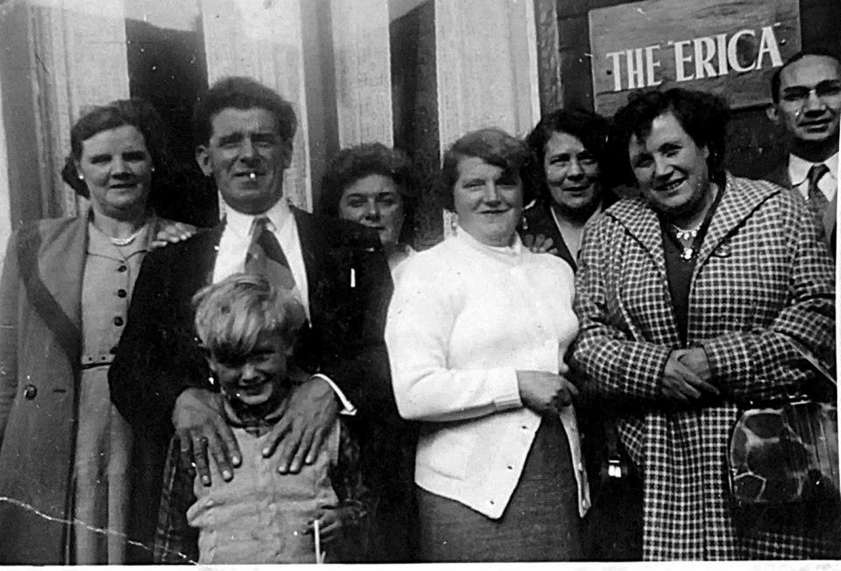 Grandad (second left) and grandma (third left) outside grandma's seaside guesthouse, The Erica, pictured with smiling guests and my brother as a child, in the late 1950s.