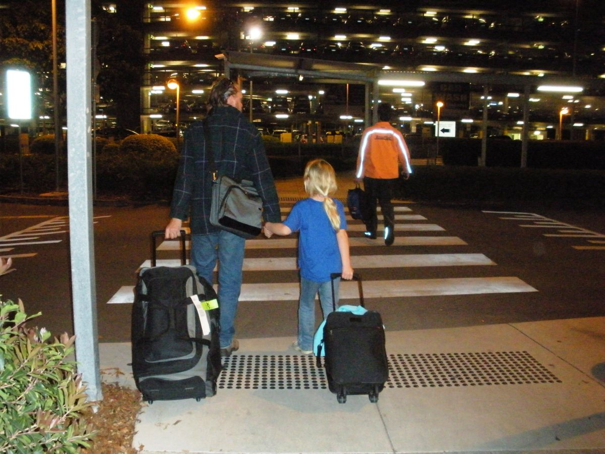 From another hub ... Real photo, real family members. Our friends would recognize my husband and daughter but strangers would have little chance of identifying them - or even the airport we were at.