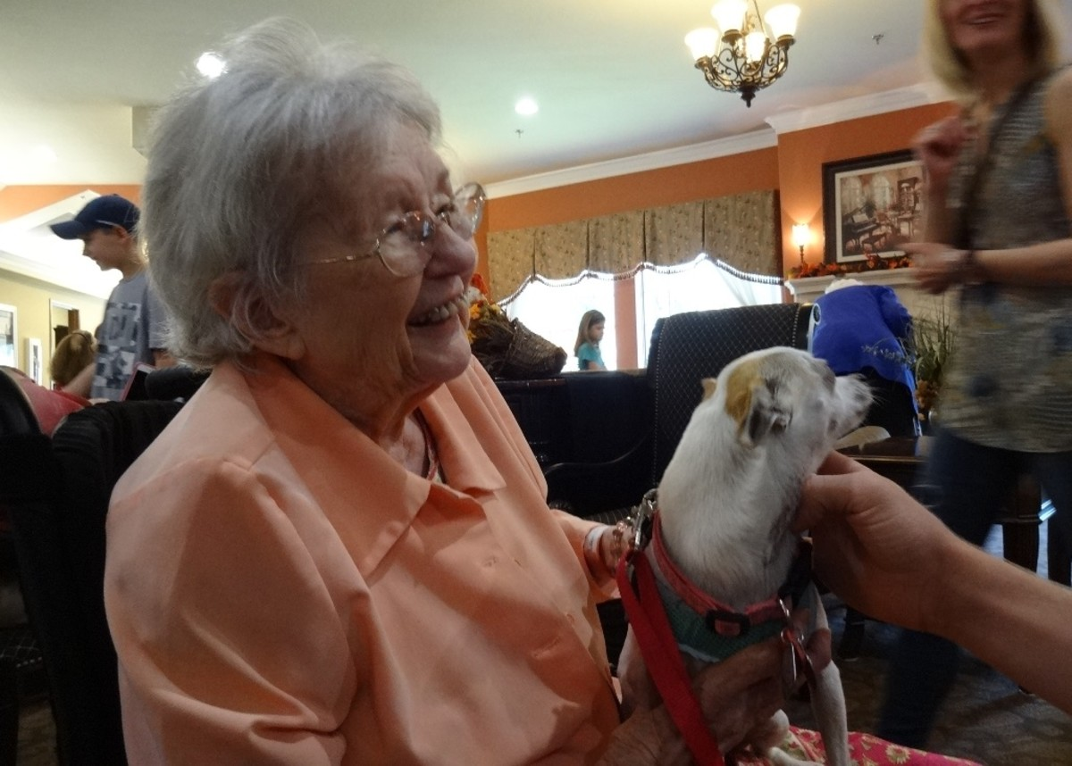 When the school children visit, they bring along their dog to the skilled nursing facility.