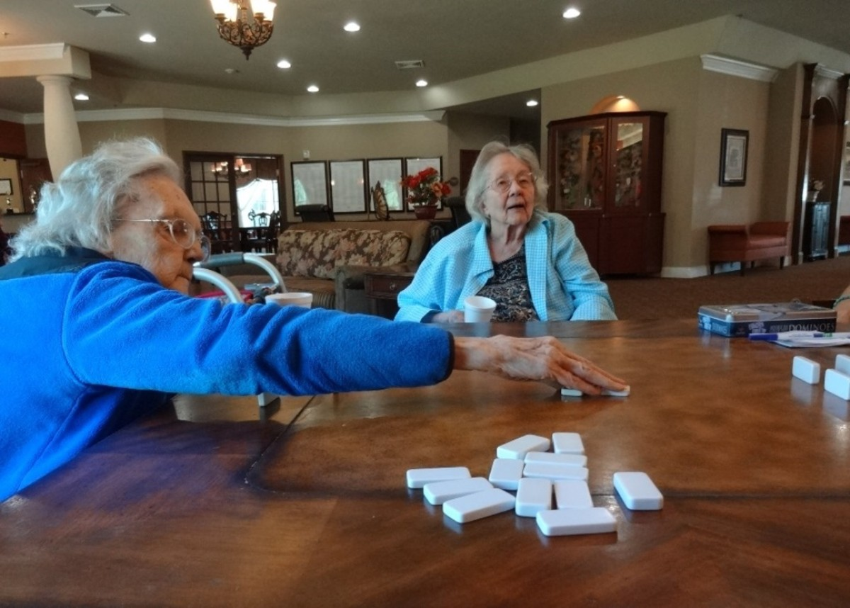 Mind-stimulating games like Dominoes, or card games are valuable ways to share time with residents.