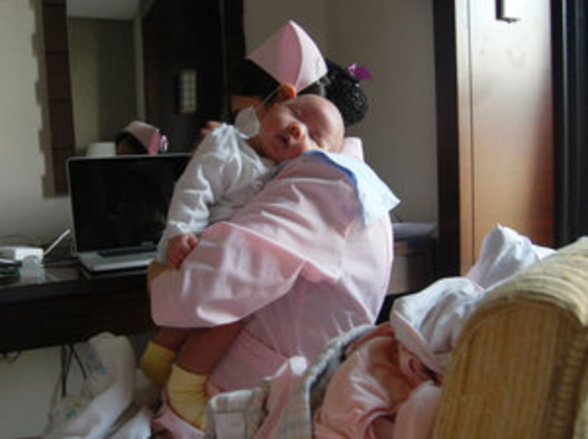 A nurse cares for baby while her mother is Sitting The Month