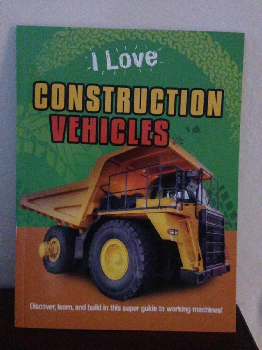 32-page book with real-life photos of construction equipment