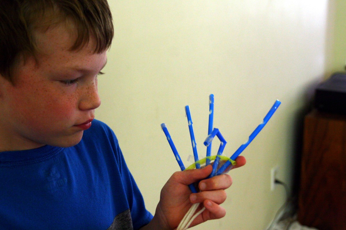 "A simple combination of straws and string allows a child to create a ""robotic"" hand."