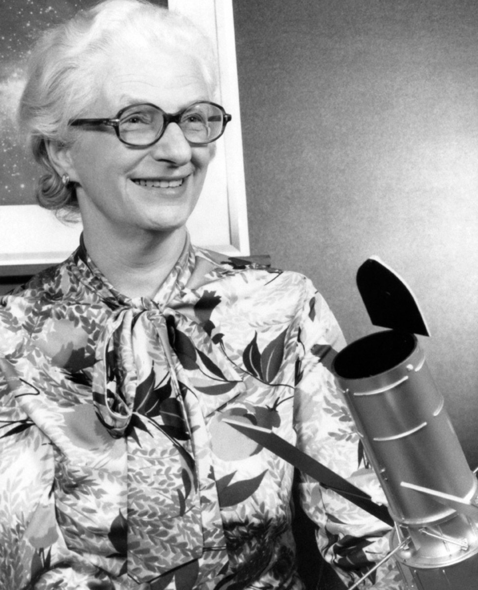 Nancy Roman with a model of a space telescope.