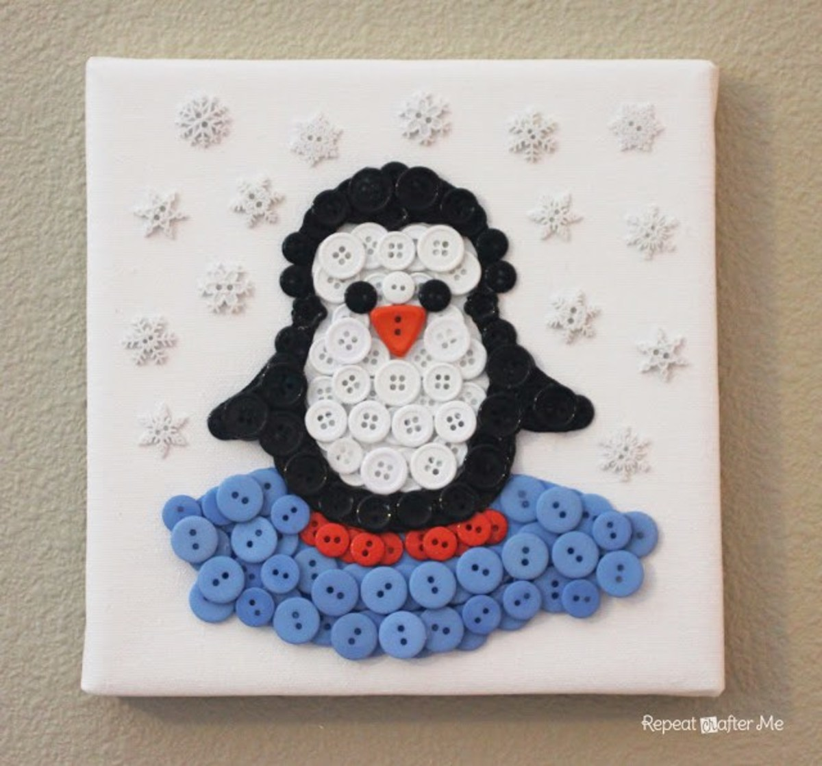 I love button crafts and this button penguin is easy to make, and adorable!