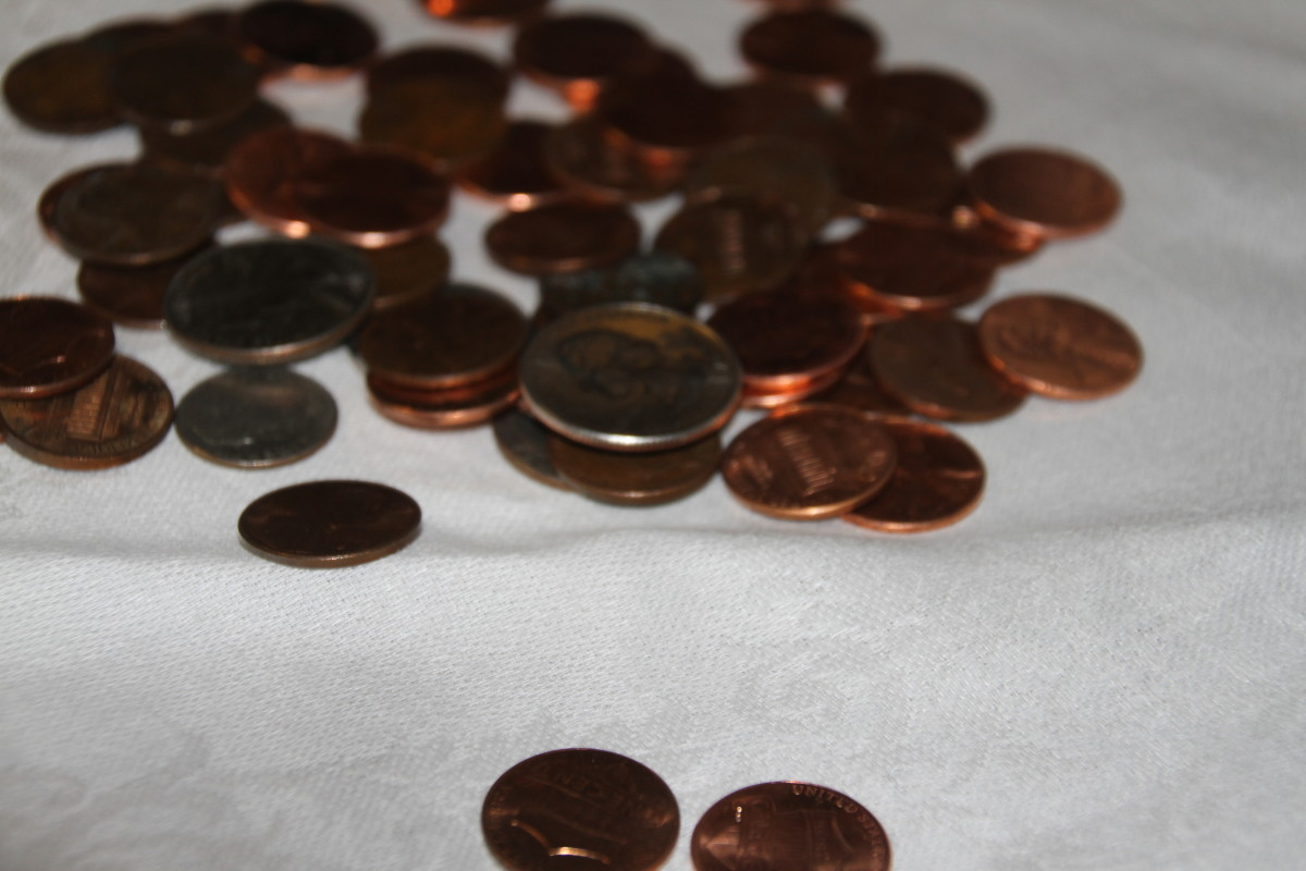 Students with visual impairments use diameter, thickness, and edge texture to identify coins.