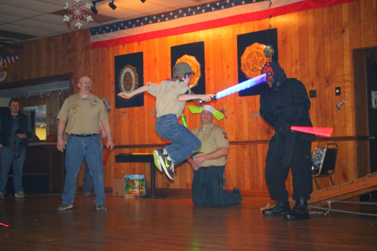 Allowing the scouts to use only four moves (jump, duck, strike up, strike down) helps the Jedi training move along quickly. Darth Maul was swiftly defeated by our young scouts!