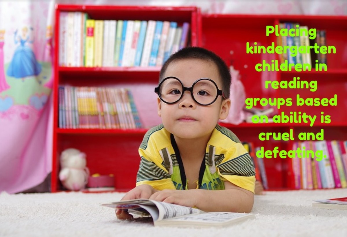 Teaching children to read in kindergarten has no long-term benefits. Placing them in reading groups according to ability makes those in the low group feel stupid and inferior.