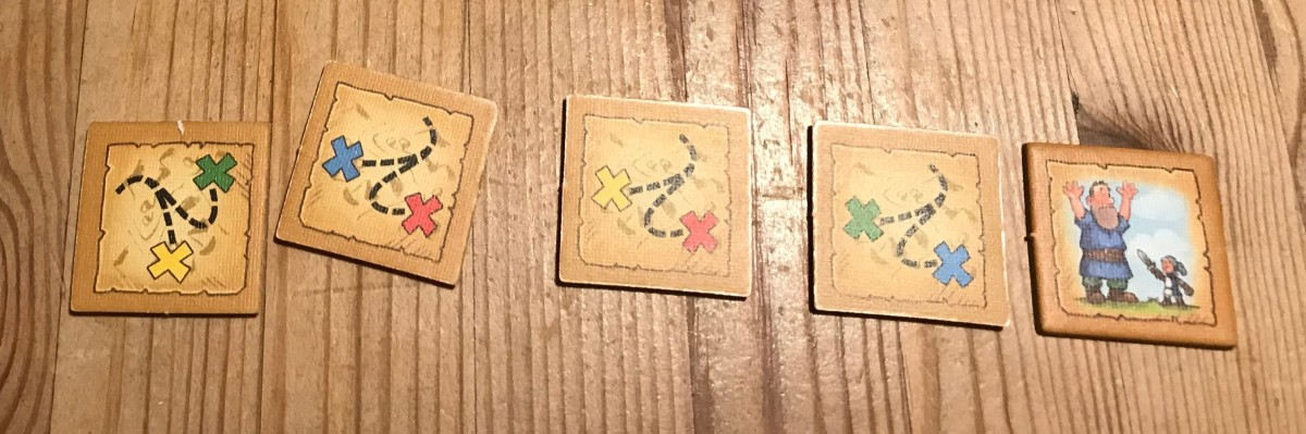 The backs of the tokens show the route you must take to complete the quest.