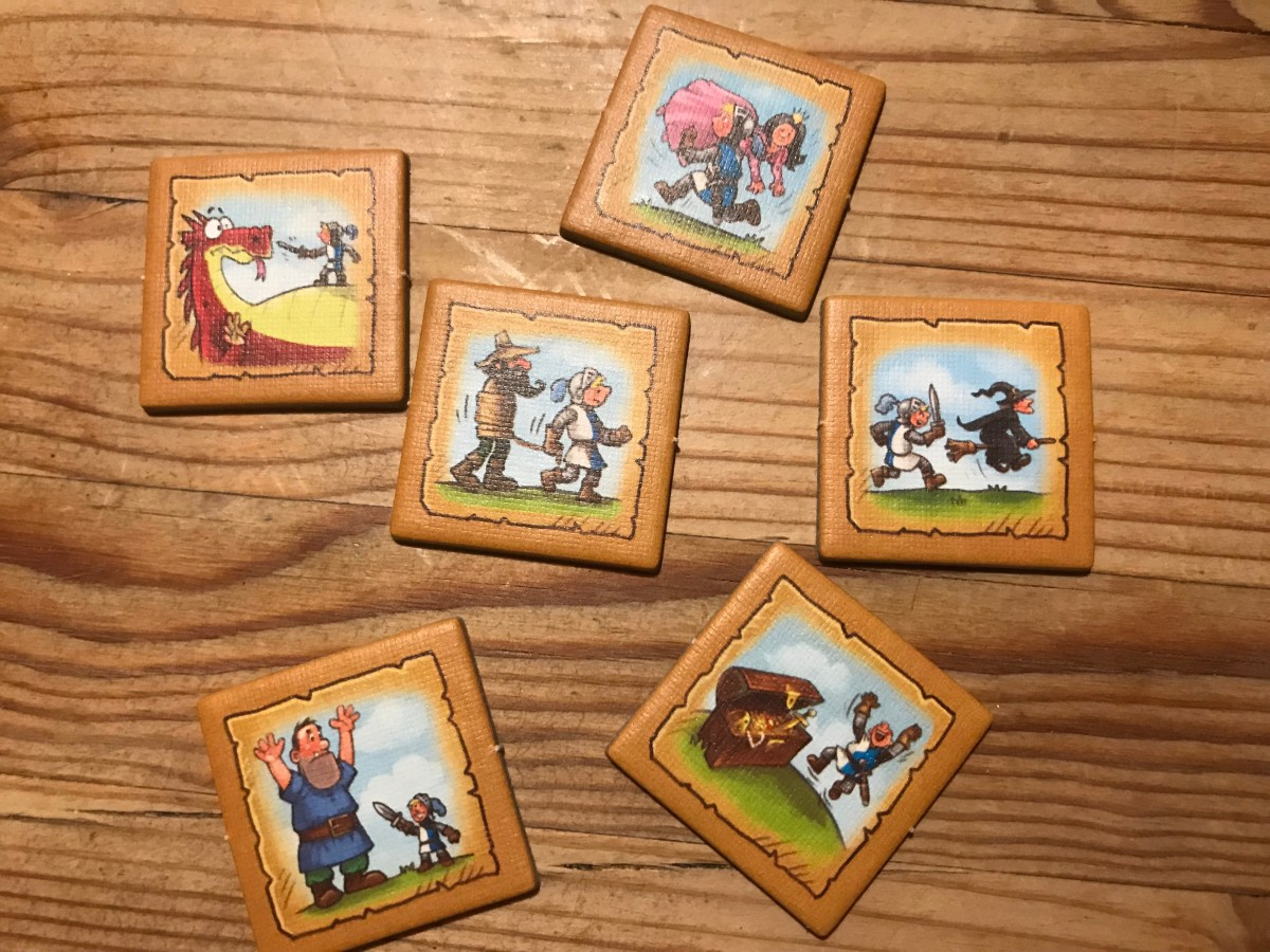 The fronts of the quest tokens show what must be accomplished.