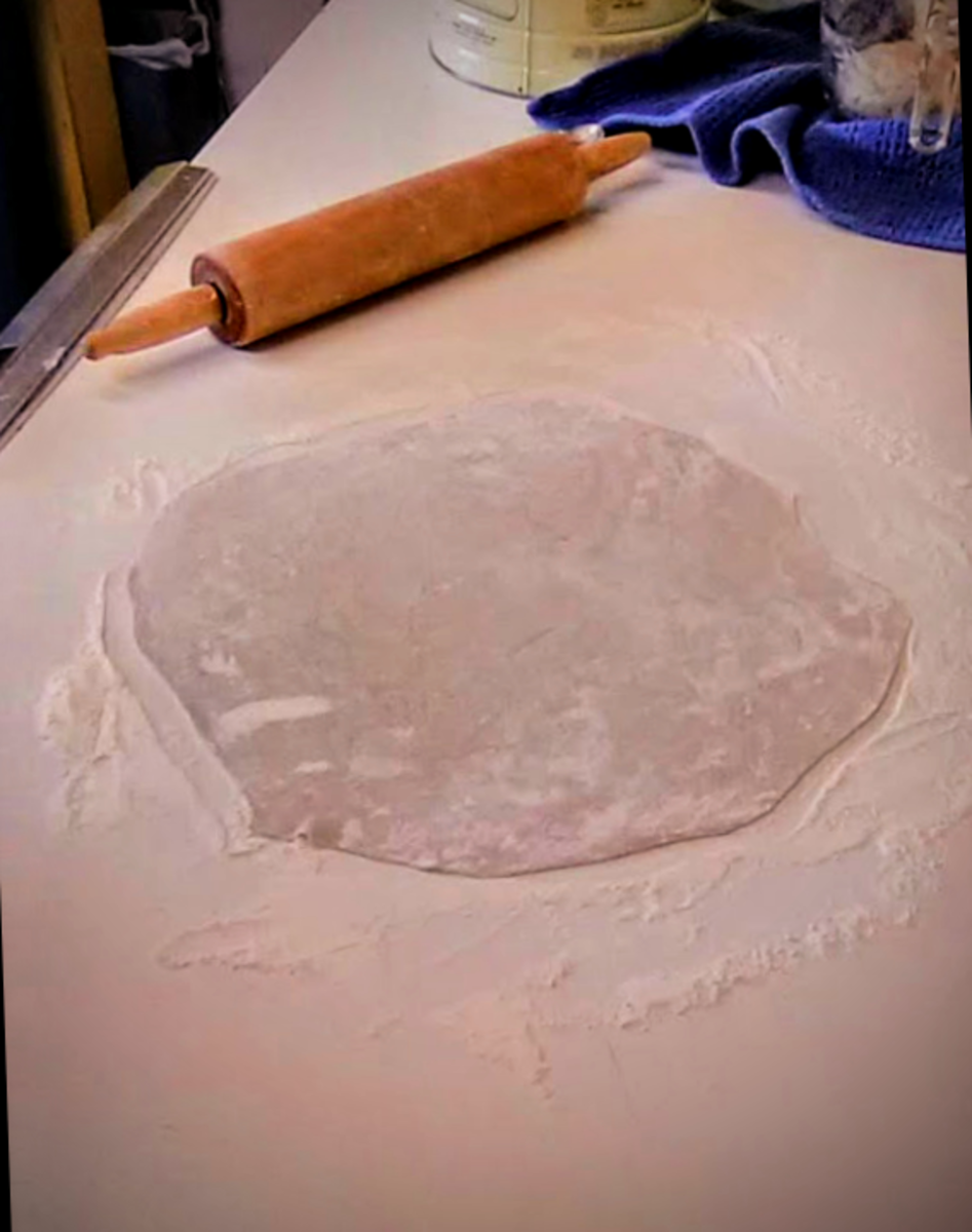 ...to round. This crust is ready to transfer. If you are using a cookie sheet, making two smaller crusts, set side-by-side, can be easier.